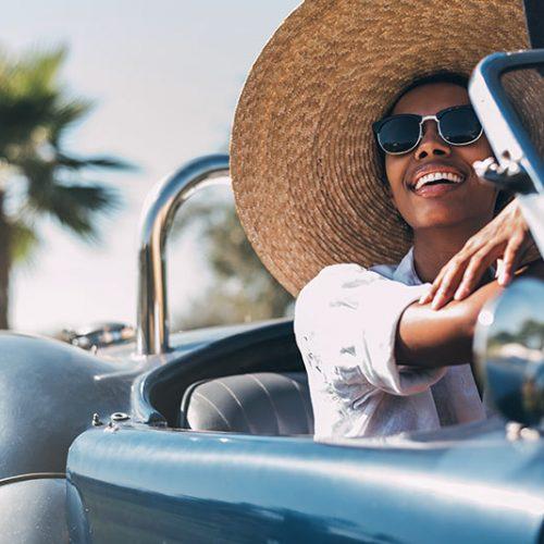 black-woman-driving-a-vintage-convertible-car-BFYH7K3.jpg