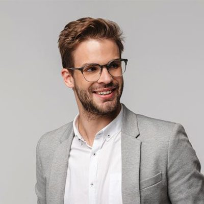 portrait-of-happy-young-businessman-posing-at-came-3MRXVKU.jpg